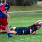 Arrowtown's Ben Carr reaches out to score against Maniototo during a Central Otago Premier rugby...