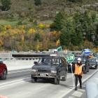 Queenstown resident Mike Legge leads the public charge across the second lane of the Kawarau...