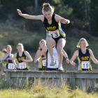 Hill City University's Rebecca Allnutt leads the field in the women's cross country relay race at...