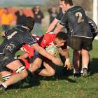 Clutha's  Ropeni Fesilafai spots a gap in the Clinton defence and dives over for the first of his...