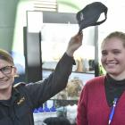 Royal New Zealand Navy Midshipman Sarah Adams (28) tries to persuade University of Otago  student...