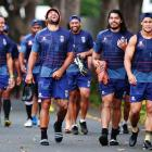 Adam Blair laughs as Tohu Harris (middle) and Roger Tuivasa-Sheck walk next to him at a Warriors...