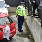 A car was driven through a fence in a car park this afternoon. Photo: Gregor Richardson