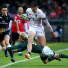 England's Jonny May runs the ball up against South Africa. Photo: Reuters