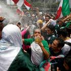 Mexican fans celebrate their team's win at the Angel of Independence monument in Mexico City....