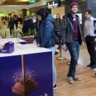 Cadbury employees Ben Epton and Yamta Zubiri hand out free chocolate to Eve Moodie and Book...