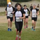 Celia Lie competes in the Barnes Cross-country races at Kettle Park yesterday. Photo: Gregor...