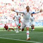 Portugal's Cristiano Ronaldo celebrates his goal during Portugal's win over Morocco this morning...