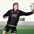 All Black first five-eighth Damian McKenzie catches a ball at training at Forsyth Barr Stadium...