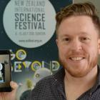 New Zealand International Science Festival director Dan Hendra demonstrates a phone app which...