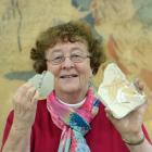 University of Otago geology department Associate Prof Daphne Lee holds two of hundreds of...