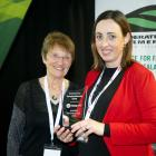 Southland Federated Farmers meat and wool chairwoman Bernadette Hunt (right) receives the...