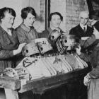 Women workers being taught engine-stripping work on a Fiat 250 h.p. aero engine at a technical...