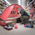 Tony Watts demonstrates the use of a First Aid Pod in a Dunedin supermarket.  PHOTOS: SUPPLIED