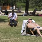 Too hot to work, Britons de-suit in the park instead during a London heatwave. Photo: Getty Images
