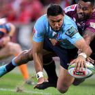 Curtis Rona dives over to score for the Waratahs against the Reds. Photo: Getty Images