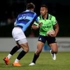 Highlanders wing Tevita Li (right) prepares to fends off French Barbarians opposite number Hugo...