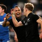 Aaron Smith and Damien Mackenzie celebrate the latter's controversial first half try. Photo:...
