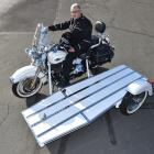 Hope and Sons funeral director John Finlayson makes sure the company's new Harley-Davidson hearse...