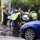 A Kaikorai Valley College pupil is helped to an ambulance after being hit by a truck yesterday...