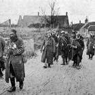 French soldiers from the trenches after receiving first aid: walking cases en-route to hospital. ...