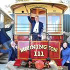 Celebrating the delivery of cable cars to Mornington are (from left) Trevor Goudie, Mac Gardner,...