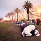 Muslims pray as they gather for the sighting of the moon. Photo: Reuters