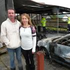 Balclutha couple Glenn Burns and Giselle Cooper take stock of the damage after a fire destroyed...
