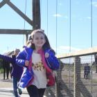 Visiting Oamaru, and enjoying the new pedestrian bridge, is Uma Reid (9), of the Philippines....