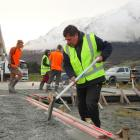Queenstown Concrete Floors owner Mana Skipper works on the first home foundation to be laid at...