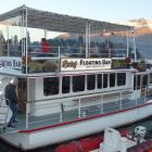 Perky's Bar at its Queenstown Bay mooring. Photo: Guy Williams