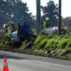 Emergency services at the scene of a single-vehicle crash north of Oamaru this morning. PHOTO:...