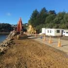 Work continues on widening the road beside Maramoana Reserve at Edwards Bay, between Broad Bay...