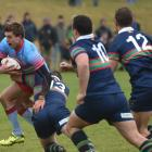 South Otago centre Jonny Sargent breaks the tackle of Central Otago opposite number Angus Gibb on...