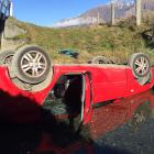 The car that left the Wanaka-Mount Aspiring road yesterday and landed upside down in a creek. One...