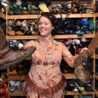 Actress Nadya Shaw Bennett displays items from the Fortune Theatre's wardrobe that have been...