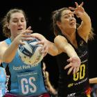 Steel goal shoot Jennifer O'Connell (left) secures the ball ahead of Magic goal defence Katherine...