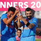 India players celebrate with the trophy after beating England in the third T20 match at The...