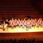Conductor John Buchanan leads the Dunstanza Senior Girls' choir with accompanist Sharon McLennan ...