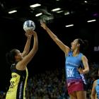 Southern Steel goal keep Courtney Elliot (centre) defends as Central Pulse goal shoot Aliyah Dunn...
