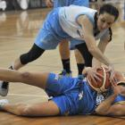 Otago Gold Rush player Dayna Turnbull (on ground) tries to prevent Auckland Dream player Amanda...