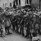 The famous Black Watch in a village answering a roll call prior to going into the firing line. —...