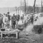 The entente cordiale: British and French soldiers cooking together in a wood during the April...