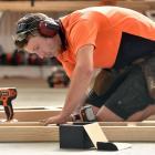 2017 New Zealand Certified Builders Apprentice Challenge Otago winner Chris McLean works on his version of an outdoor table.