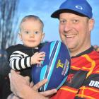 Chris Bell with his son Spencer (9 months) at home this week. Photo: Christine O'Connor