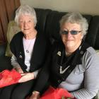 Cradling the roses they received are Balclutha Inner Wheel founding members Mary Hay (left) and...