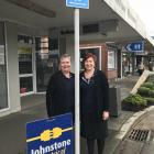 Johnstone Electrical staff members Andrea Leonard (left) and Lisa Morris are unaware of parking...