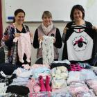 One hundred sets of pyjamas all ready to be packed up for Foster Hope Otago thanks to three...