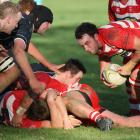 Clutha lock Scott Hollows picks up the ball from the base of a ruck and drives for the line in...