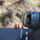 A motorist was injured in after their car rolled on the Crown Range Rd this morning. Photo: Sean...